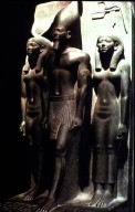 King Menkaure (Mycerinus) between Goddess Hathor and a Deity