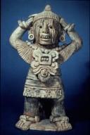 Xipe Figure with Vase