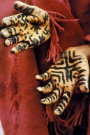 Groom's Hands Painted with Henna-Leaf Paste