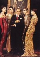 Norman Norell Surrounded by Models in Gowns
