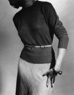 Woman in a Pencil Skirt and Sweater