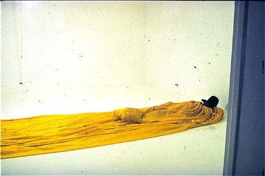James Lee Byars in his Yellow Banana