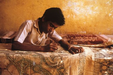 Craftsperson Drawing Out Design for Kalamkari Cloth