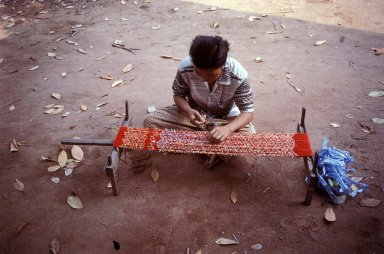 Woman Tying Matmi Patterns Into Yarn
